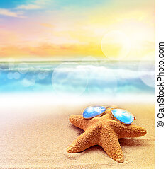 Starfish in sunglasses on the summer beach