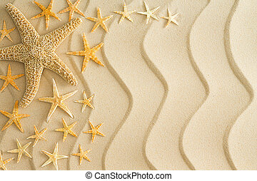 Starfish on golden beach sand with wavy lines - Scattered...