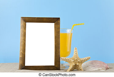 starfish, shell, orange juice and photo frame in the sand for relaxation on a blue background
