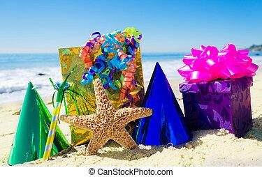 Starfish with Birthday decorations on the beach - Starfish...