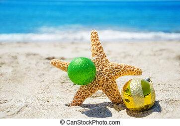 Starfish with Christmas ball - holiday concept