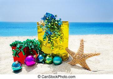 Starfish with Christmas balls and gifts - holiday concept