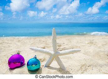 Starfish with Christmas balls - holiday concept