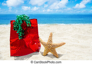 Starfish with gift bag on the beach - holiday concept