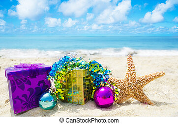 Starfish with gift boxes on beach - holiday concept