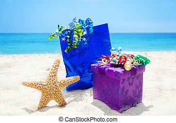 Starfish with gifts on the beach
