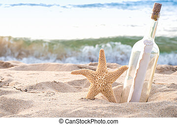 starfish with message in a bottle on the seashore