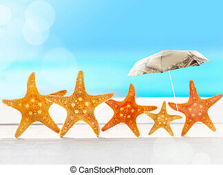 starfish with parasol on the beach
