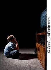 staring at television