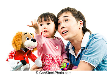 Photo of father and child watching at something with cute toy near by
