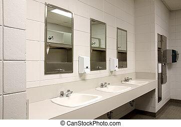 Stark public bathroom - Perspective shot of a countertop...