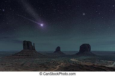 starry night sky in desert landscape of monument valley