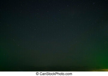 starry nights and green light background. Real a lot of star on black sky.