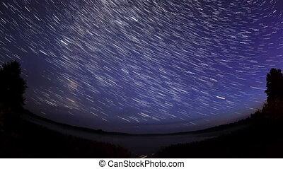 Starry sky over the lake Moiseevskoe, Valdaysky district, ...