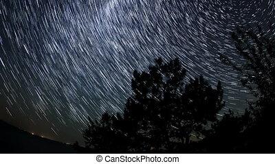 Starry sky over the reservoir in Kremenchuk. Mountain...
