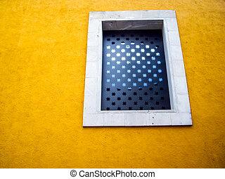 Starry Window on orange adobe wall