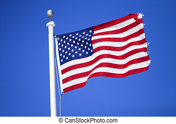 Stars and Stripes - American flag flying over a blue...