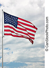 Stars and Stripes - American flag against clouds