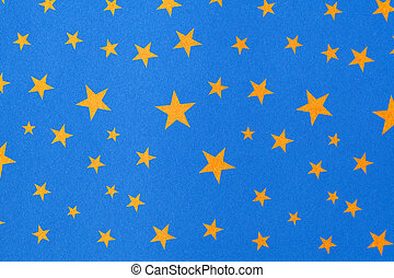 Stars - Close up of a blue backdrop with yellow stars