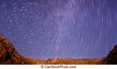 Stars line over the mountains. Time Lapse