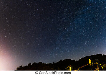 Stars over the forest and a house at the Troodos mountains