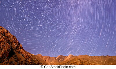 Stars over the mountains. Line. Time Lapse