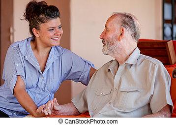 starszy człowiek, z, pielęgnować, carer, albo, granddaughter.