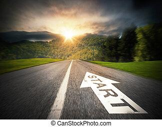 Start advancement - Road with big white arrow on asphalt