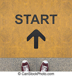 Start arrow on the yellow background - Pair of shoes...