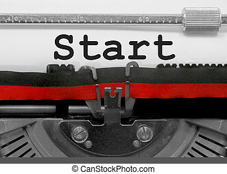 Start by the old typewriter on white paper
