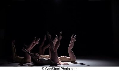 Start of contemporary dance of five talanted dancers in white suits, sensual, on black background, shadow, slow motion