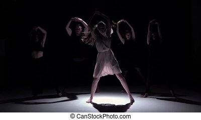 Start contemporary dance of five dancers on black, shadow, slow motion