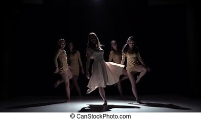 Start contemporary dance of five girls in white dresses, on black, shadow, slow motion