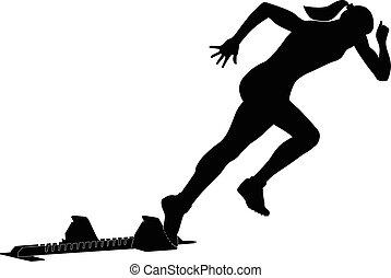 start female runner from starting blocks sprint competitions