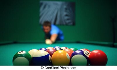 Start Game Blurred man Lines To Hit Ball On Pool Table. HD....