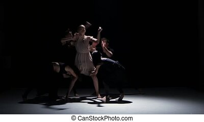 Start of contemporary dance performance of five dancers on black, shadow