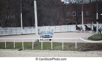 start of horse competitions on hippodrome with autostart car