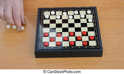 start playing a game of white checkers