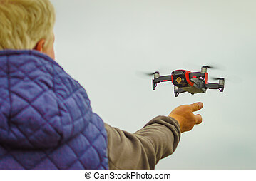 Start the drone, launching from hand