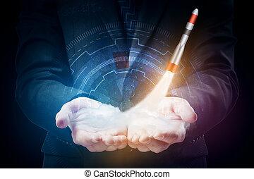 Start up concept - Businessman holding digital hologram with...