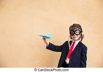 Start up - Portrait of young businessman with paper...