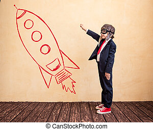Start up - Portrait of young businessman with drawn rocket....