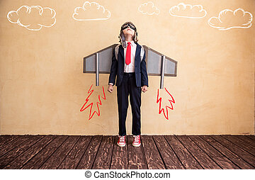 Start up - Portrait of young businessman with toy paper...