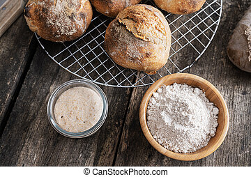 Starter yeast and homemade sourdough bread - Top view of ...