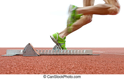 Starting blocks - Action packed image of an athlete leaving...