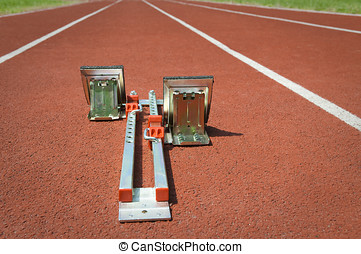 Starting blocks on tartan running track