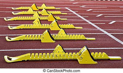 starting blocks - yellow starting blocks i track and field