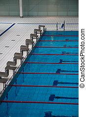 starting blocks - the row of starting blocks of a swimming...