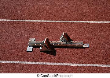 Starting blocks in athletic stadium