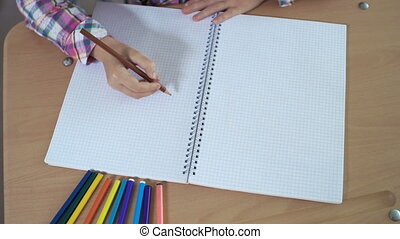 Starting Drawing - High angle view of kid hands drawing in...